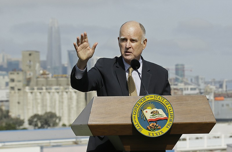 California Gov. Jerry Brown speaks before signing a number of bills to help a...