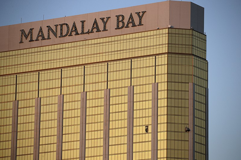 Drapes billow out of broken windows at the Mandalay Bay resort and casino Mon...