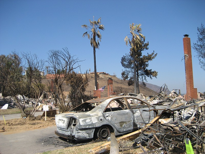 A burned-down car in Aguamiel in Rancho Bernardo is shown in this photo, Oct....
