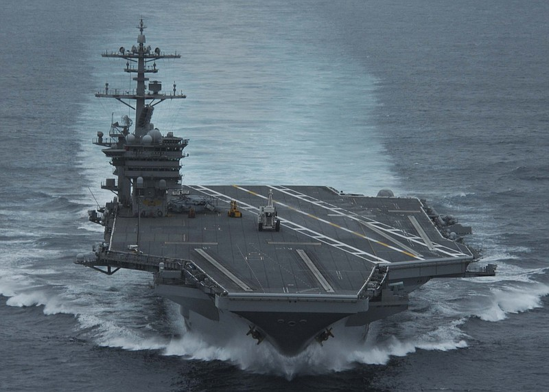 The aircraft carrier USS Theodore Roosevelt (CVN 71) conducts high speed runs...