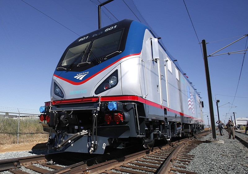 In this May 13, 2013, file photo one of the new Amtrak Cities Sprinter Locomo...