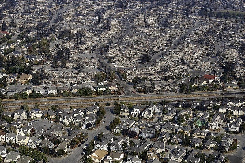 Homes destroyed from fires are seen from an aerial view in Santa Rosa, Calif....