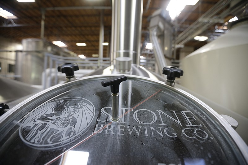 Workers brew, bottle and pack craft beer at Stone Brewery in scondido, Calif....