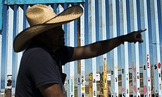 Enrique Chiu, a Tijuana-based muralist, is silh...