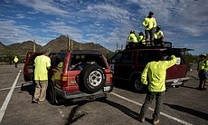 Volunteers with Aguilas Del Desierto load vehicles at Organ Pipe Cactus Natio...
