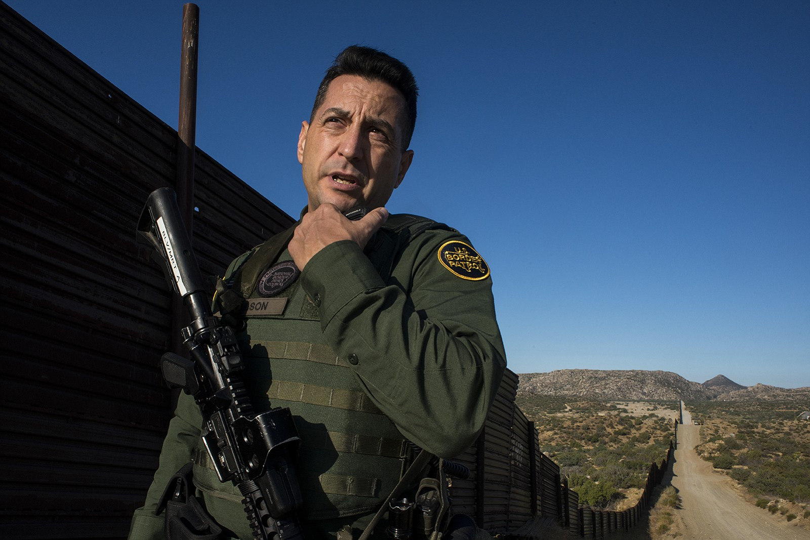 Border Patrol agent Joshua Wilson radios dispatchers to notify them of his lo...