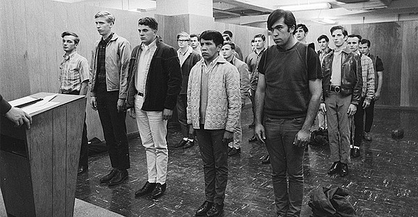 Young men are sworn in and drafted into the Vietnam War. ...