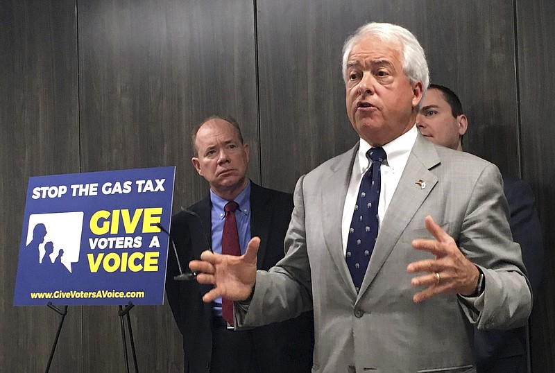 California Republican gubernatorial candidate John Cox, right, speaks in Sacr...