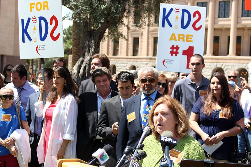 Dana Wolf Naimark of the Children's Action Alliance speaks at a rally, in Pho...