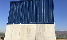 (6) A border wall prototype stands by the U.S.-...