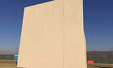 (5) A border wall prototype stands by the U.S.-...