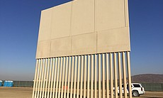 (4) A border wall prototype stands by the U.S.-...