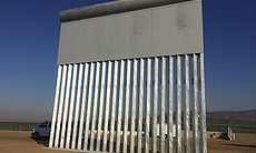 (2) A border wall prototype stands by the U.S.-...