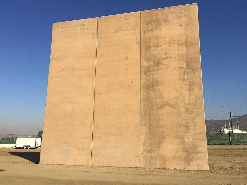 (1) A border wall prototype stands by the U.S.-Mexico border, Oct. ... ()