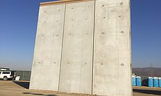 (7) A border wall prototype stands by the U.S.-...
