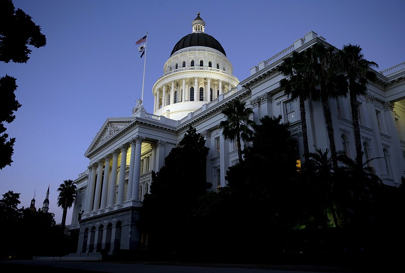 The California State Capitol in the early evening Wednesday, Aug. 31, 2016, i...