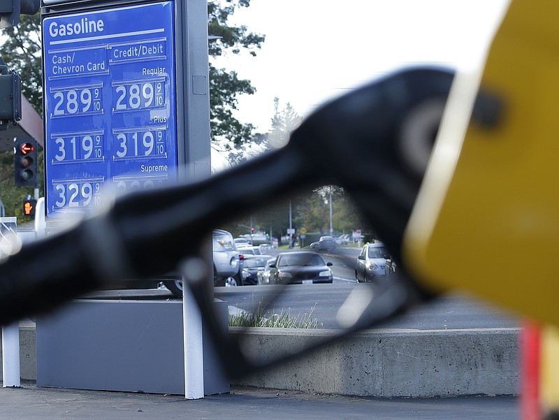 Gasoline prices are displayed at a Chevron station in Sacramento, Calif., Mon...