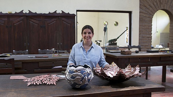Cristina Romo with her silver/ceramic pieces.