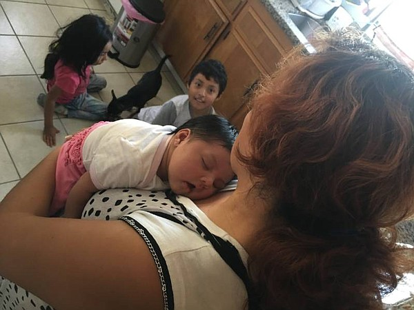 Yibi Heras cradles her newborn daughter, Yareli Esperanza...