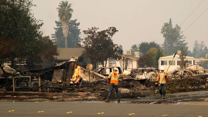 PG&E employees work in Santa Rosa after the Tubbs Fire in this undated photo.