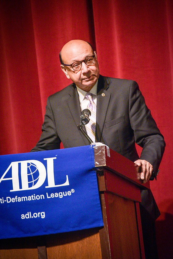 Khizr Khan, standing behind a lectern at the Anti-Defamat...