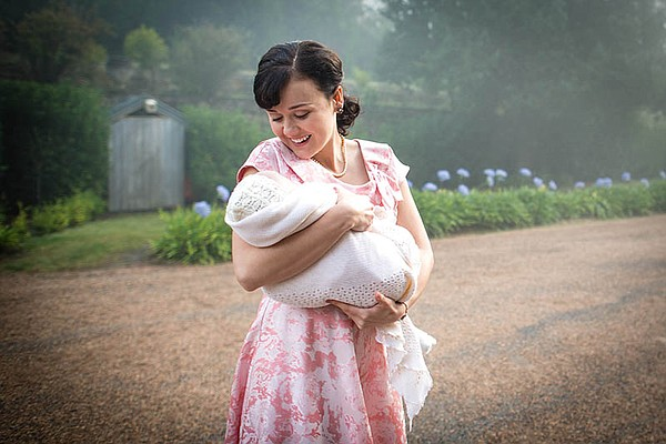 Arianwen Parkes-Lockwood as Olivia Bligh holding the baby.