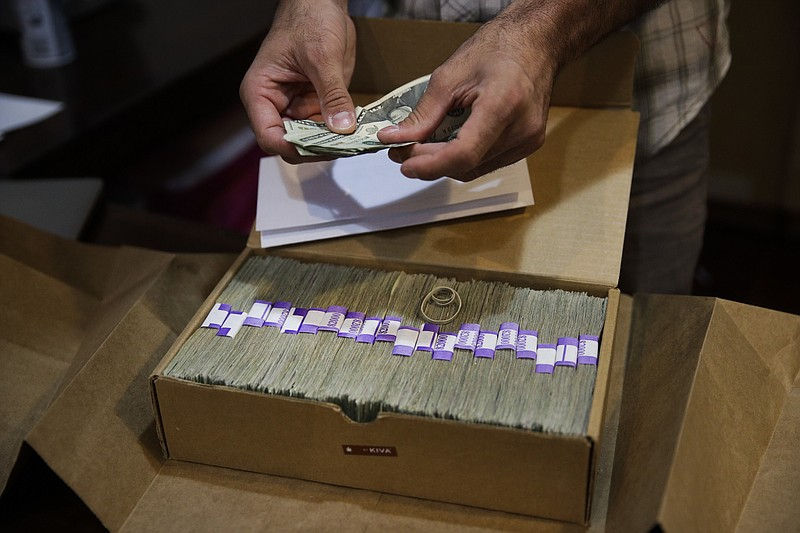 An owner of a medical marijuana dispensary in Los Angeles prepares his monthl...