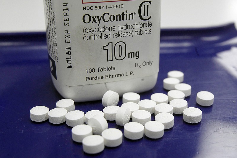 OxyContin pills arranged for a photo at a pharmacy in Montpelier, Vt., Feb. ...