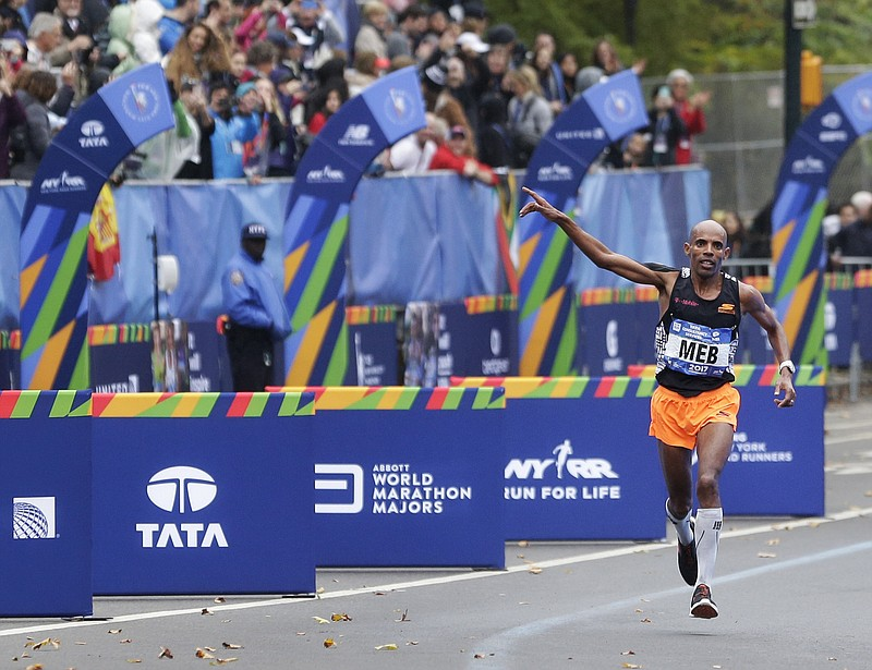 Meb Keflezighi of the United States approaches the finish line of the New Yor...