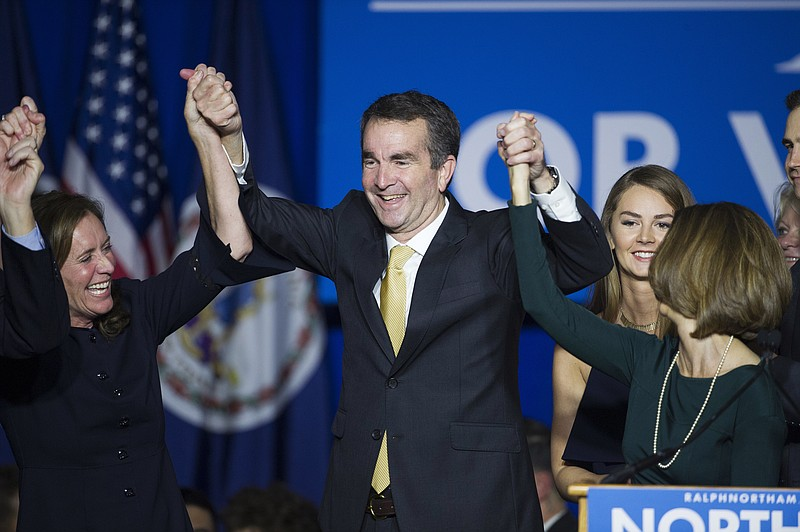 Virginia Gov.-elect Ralph Northam celebrates his election victory with his wi...