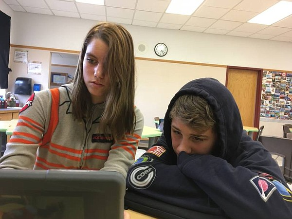 Janeane Higdon (left) and Joshua Harding work on the yearbook dedication page...