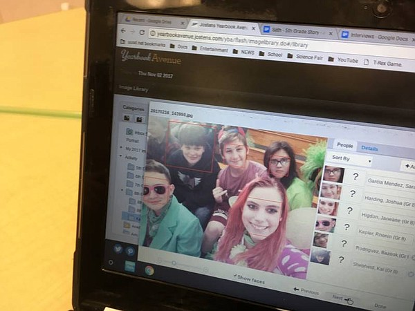 Janeane Higdon looks at a selfie she took during Spirit Week last year. She i...