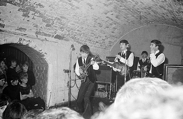 The Beatles playing at The Cavern, Liverpool, England, Au...