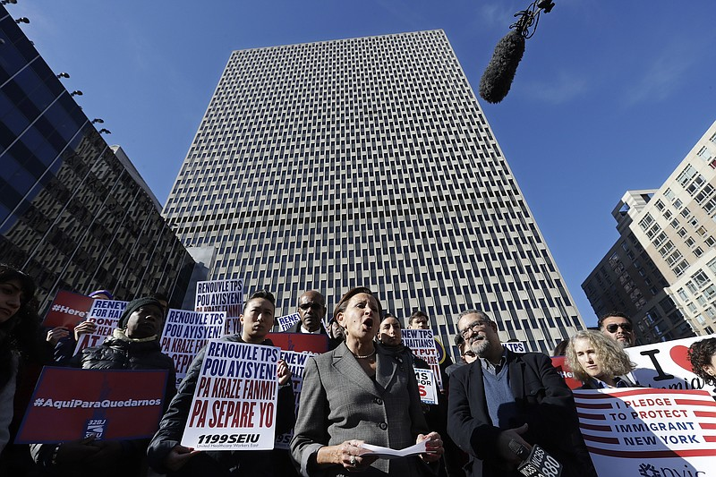 Immigration advocates rally in front of the Jacob J. Javits Federal Building ...