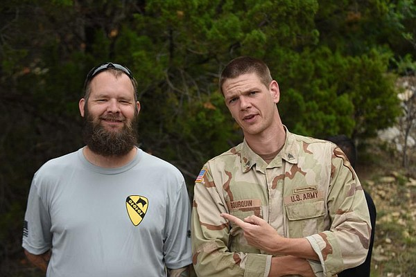 Army veteran Eric Bourquin, left, consulted on the mini-s...