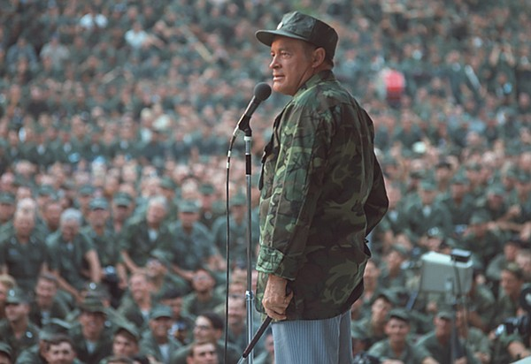 Bob Hope on stage entertaining the troops in Vietnam. (un...