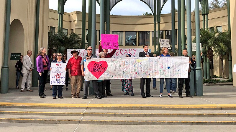 Supporters of the Save Our Escondido Library Coalition gathered outside Escon...