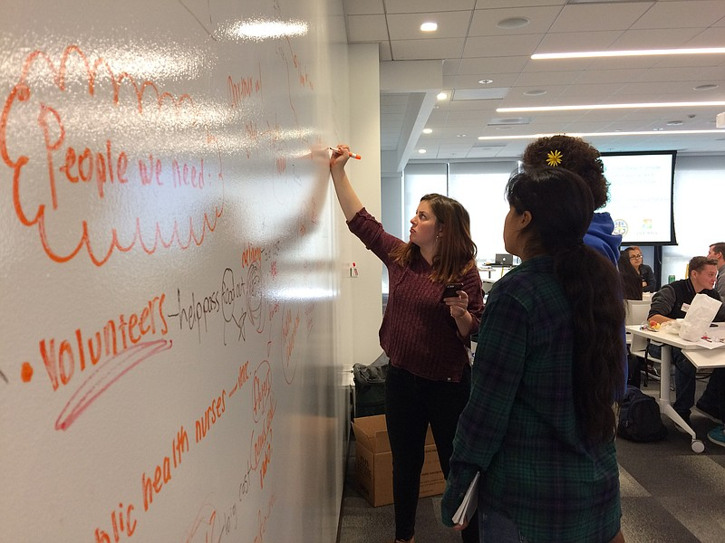 Clairemont High School student Maggie Johnson and her teammates brainstorm a ...