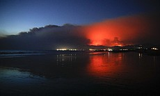 A wildfire continues to burn as its red glow is... (111057)