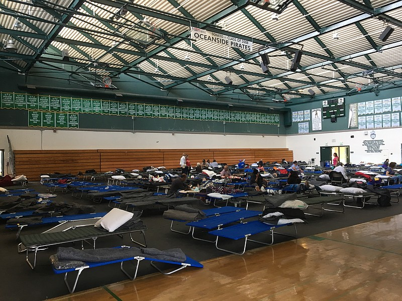 Evacuees rest at the Oceanside High School fire shelter, Friday, Dec. 8, 2017.
