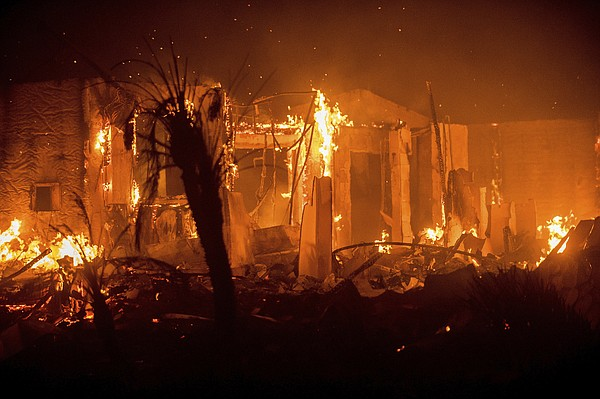 Flames consume a structure as the Lilac fire burns in Bon...