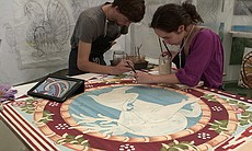 Evelyn Tauben and Jason Bashaw paint the border...