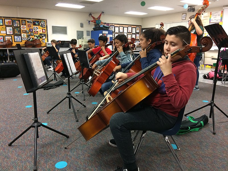 Anthony Medina plays cello with other Kellogg Elementary School students, Nov...