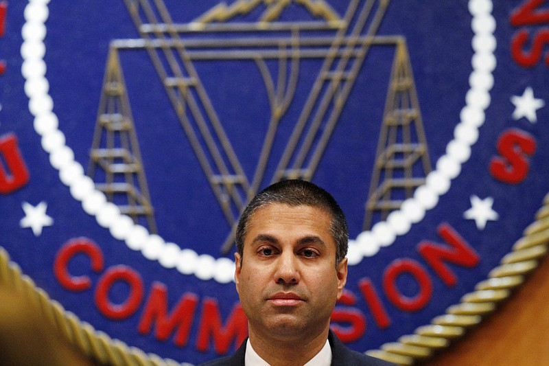 Federal Communications Commission (FCC) Chairman Ajit Pai listens during a FC...
