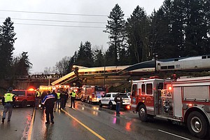 Photo for Amtrak Train Derails On Overpass In Washington State, Causing 'Multiple Fatal...