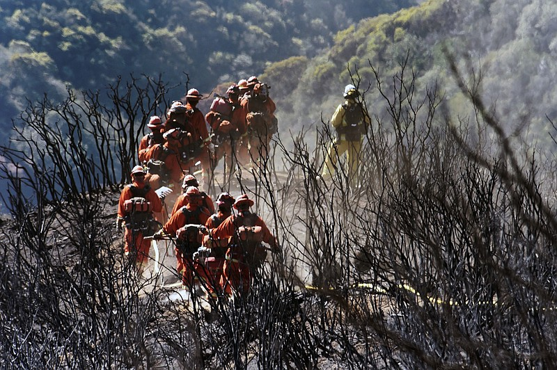 In this photo provided by the Santa Barbara County Fire Department, CAL FIRE ...