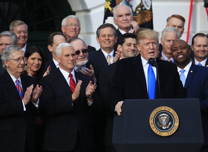 President Donald Trump, with, from left, Senate Majority Leader Mitch McConne...