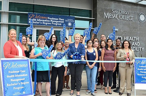 Mesa College students and administrators celebrate the opening of the school'...