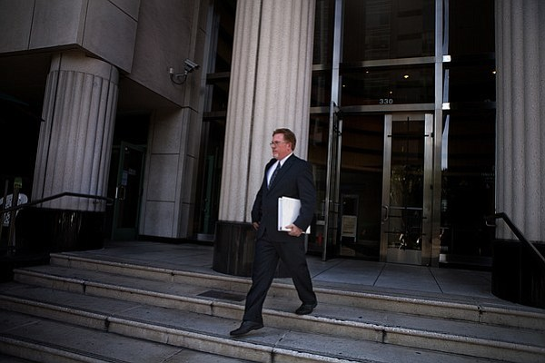 Attorney Cory Briggs leaves court after arguing a case ag...