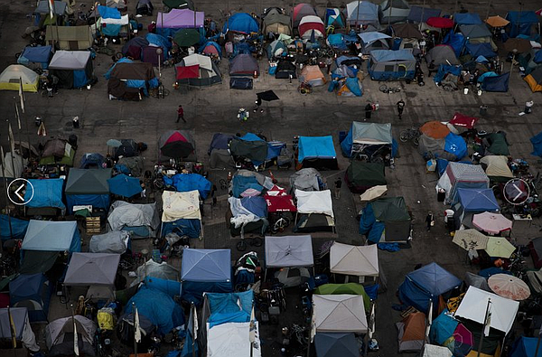A large homeless encampment is formed at the Santa Ana Civic Center on Oct. 1...